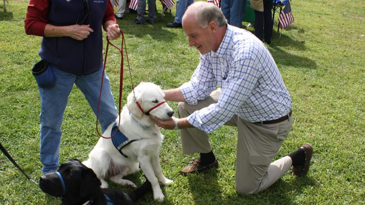 Congressman Keating petting a dog.