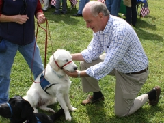 Congressman Keating petting a dog.