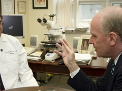 Congressman Keating talking to a doctor.