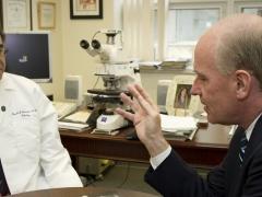 Congressman Keating talking to a doctor.