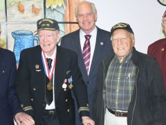 Congressman Keating standing with military veterans.